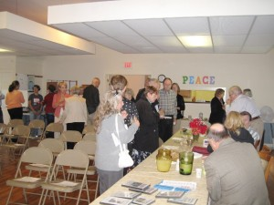 The congregation enjoying refreshments after the service.